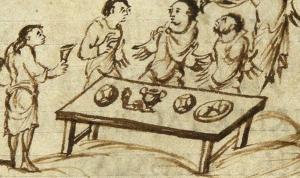 Szene aus dem Utrechter Psalter: auf dem Tisch liegen u.a. zwei Brote